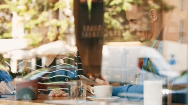 couple in cafe, using digital tablet - bar video stock e b–roll
