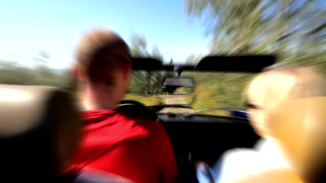 couple in convertible car driving fast. hd - just married stock videos and b-roll footage