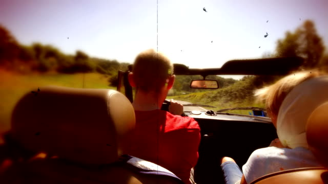 couple in convertible car old film style. hd - collector's car stock videos and b-roll footage