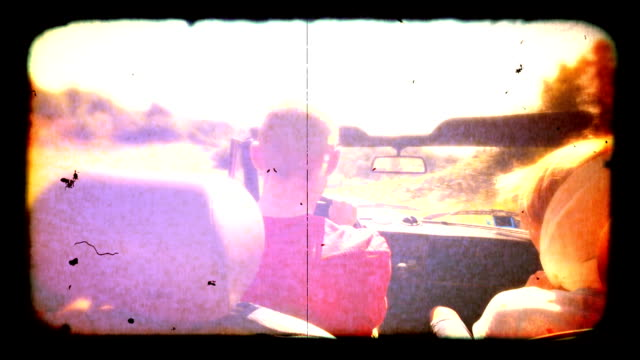 couple in convertible car old film style. hd - just married stock videos and b-roll footage