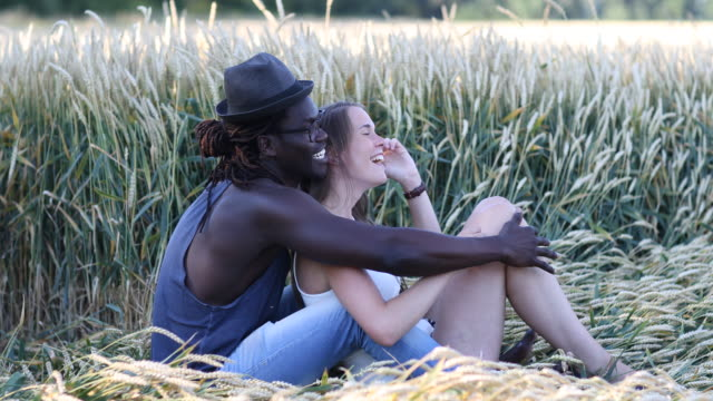 couple in cornfield - feet up stock videos & royalty-free footage