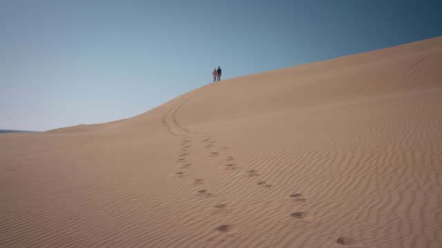 couple in desert - distant stock videos & royalty-free footage