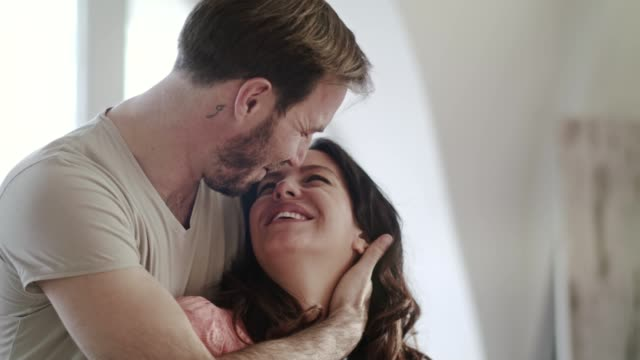 couple in embrace bonding on valentine's day - mid adult couple stock videos & royalty-free footage