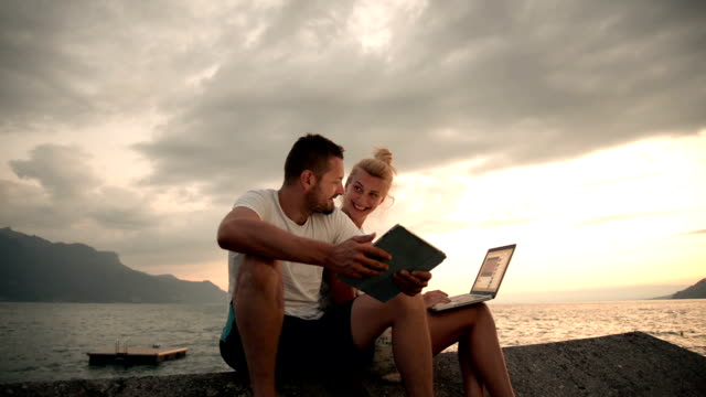 couple in holidays and technology - standing water stock videos & royalty-free footage