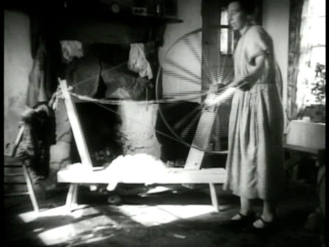 couple in horse drawn cart up country road rural woman w/ cow into building rural woman operating spinning wheel in room male working loom man... - 1937 stock videos and b-roll footage