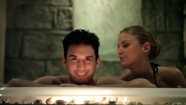 Couple in jacuzzi at spa center