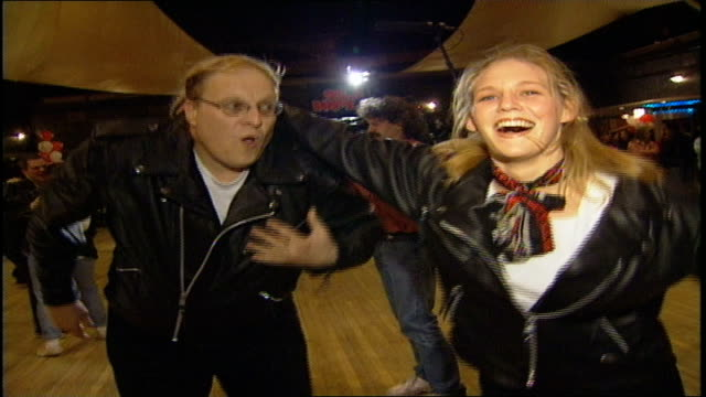 couple in leather jackets dancing at competition in nyc - 屋外遊具点の映像素材/bロール