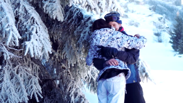 couple in love in winter nature - tree hugging stock videos & royalty-free footage