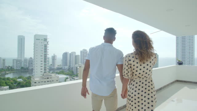 couple in love observe the city - colombian ethnicity stock videos & royalty-free footage