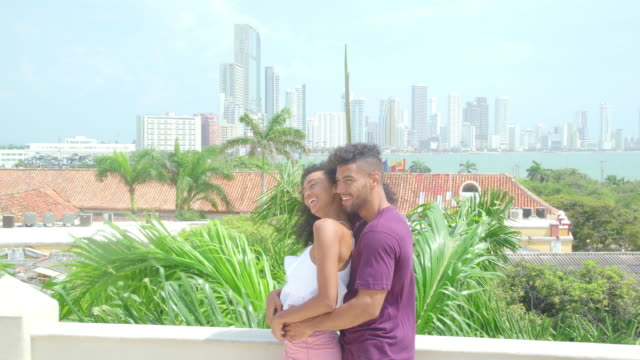 couple in love on a balcony - tree hugging stock videos & royalty-free footage
