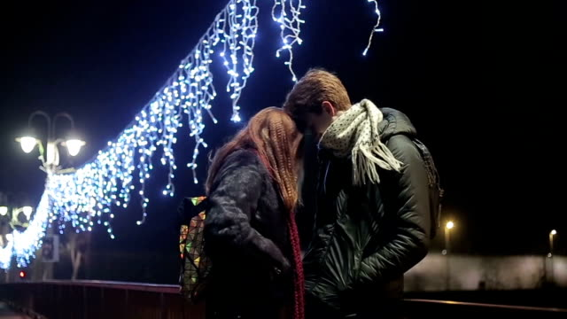 couple in love on new year's eve - innamorarsi video stock e b–roll