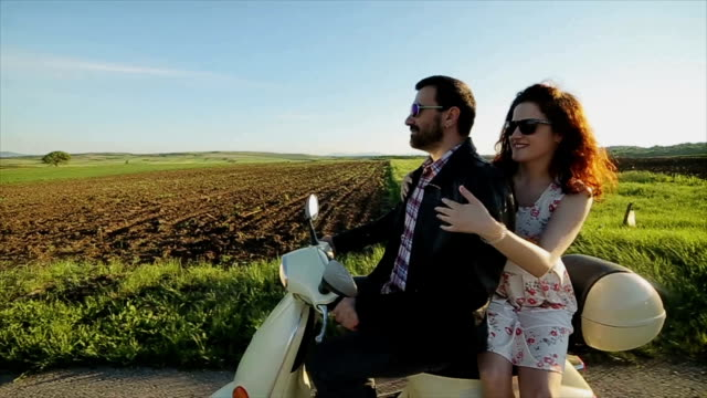 Couple in love riding a motorbike , Handsome guy and young woman travel.