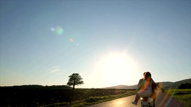 couple in love riding a motorbike - motorcycle rider stock videos and b-roll footage