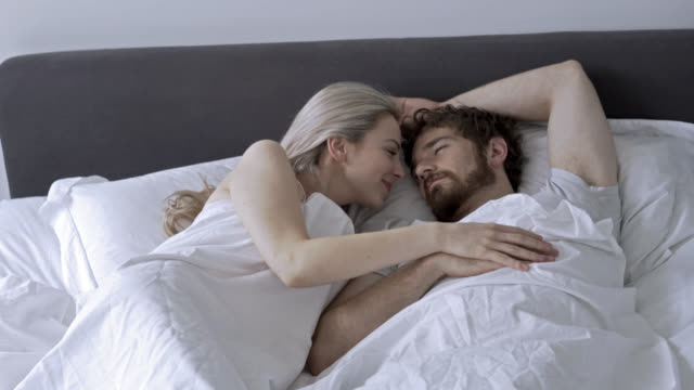 couple in love sleeping and partner being very affectionate - forehead stock videos & royalty-free footage