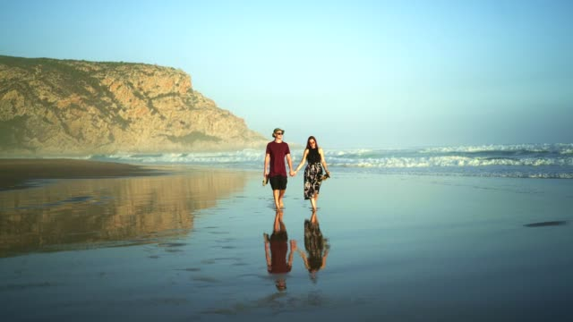 couple in love walking on a hot day on the beach - passion stock videos & royalty-free footage