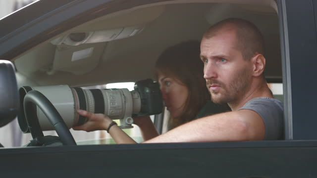 vídeos de stock e filmes b-roll de couple in minivan spying - espião