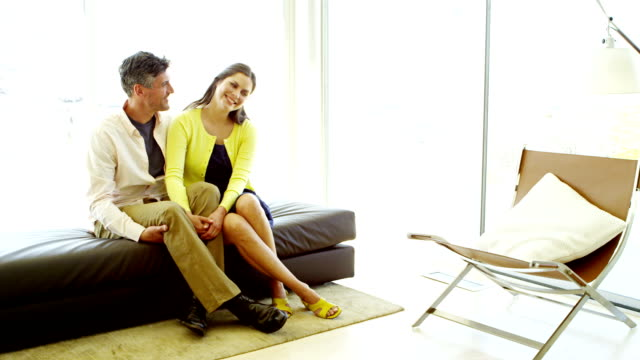 couple in modern home - mid adult couple stock videos & royalty-free footage