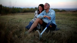 Couple in nature at sunset. Man with prosthetic leg.