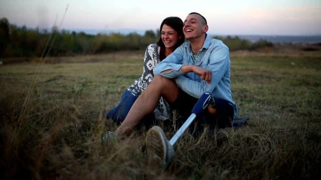 couple in nature at sunset. man with prosthetic leg. - disability stock videos and b-roll footage