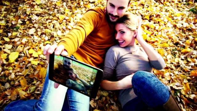 couple in park on autumn day. - lying on back stock videos and b-roll footage