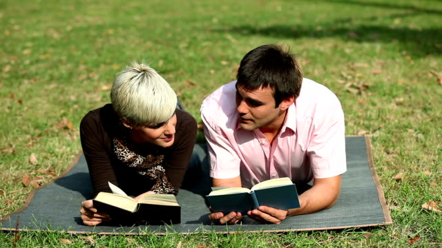 couple in park - hardcover book stock videos and b-roll footage