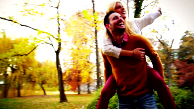 couple in park. - piggyback stock videos & royalty-free footage