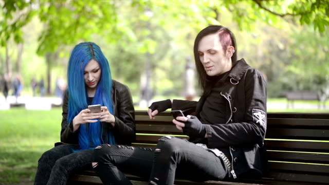 couple in park write text messages
