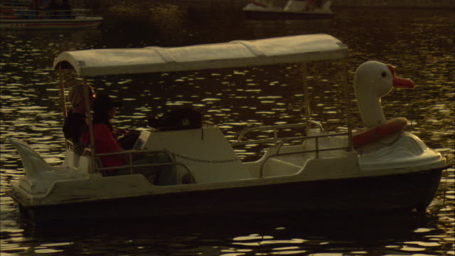 ws couple in pedal boat waving at camera, lake houhai , beijing, china - pedal boat stock videos and b-roll footage