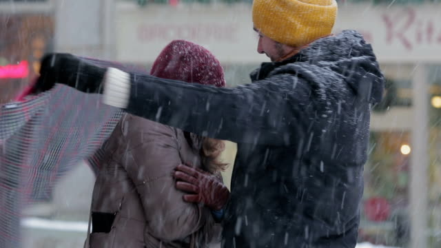 couple in snowfall frozing - shawl stock videos and b-roll footage