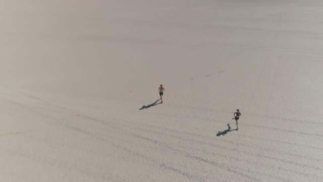 AERIAL: Couple in the Desert Running