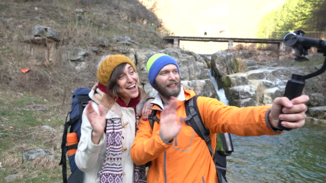 couple in the mountain hiking and vlogging - filming stock videos & royalty-free footage