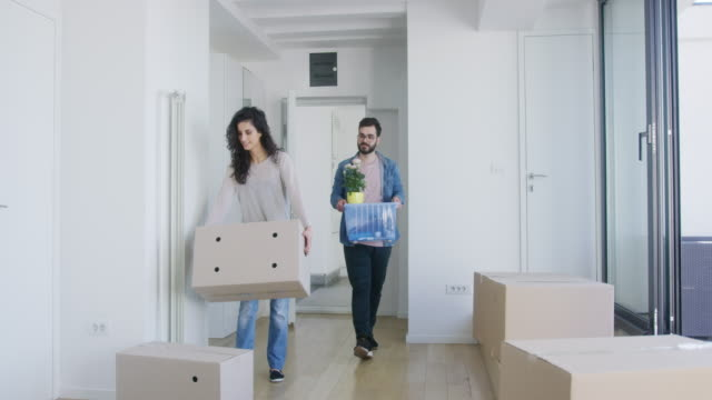 couple in their new apartment - entering stock videos & royalty-free footage