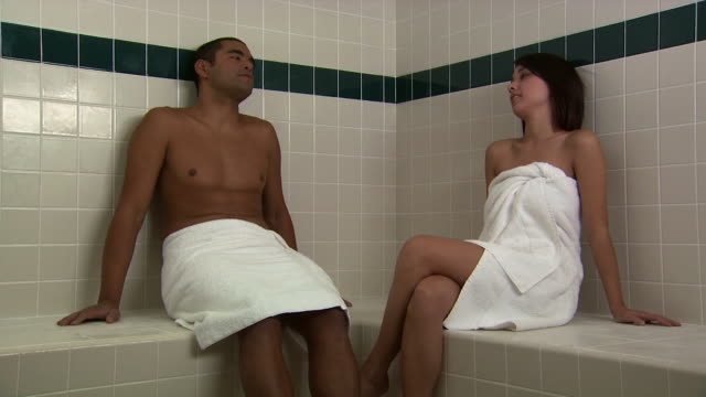 A couple in towels relaxing