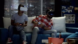 Couple in VR goggles gaming on couch