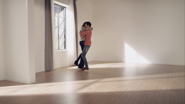Couple inspecting new apartment