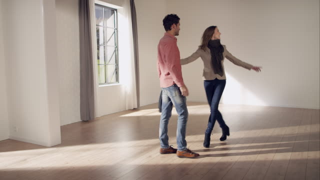 couple inspecting new apartment - buy single word stock videos & royalty-free footage