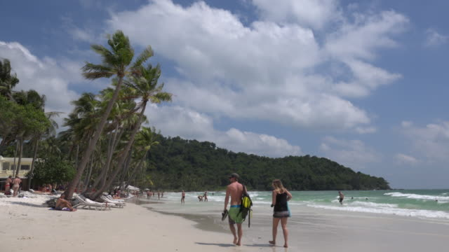 A couple is walking at Sao Beach