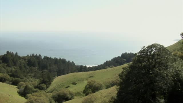 MS PAN HA Couple jogging on hill overlooking sea, Mount Tamalpais, California, USA