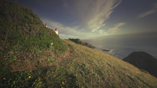 MS SLO MO POV Couple jogging on trail on Pacific Coast / Port Orford, Oregon, United States