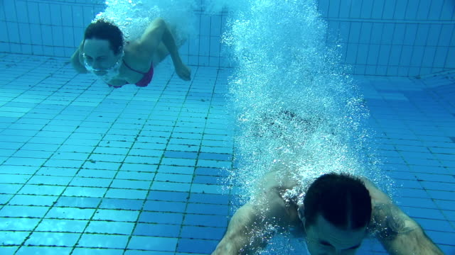 hd: couple jumping in the pool - lido stock videos & royalty-free footage