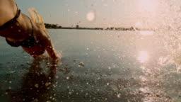 SUPER SLO MO Couple jumping into the lake