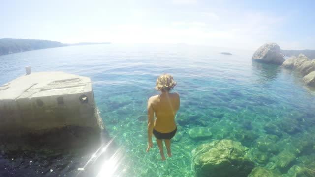 POV Couple jumping into the sea
