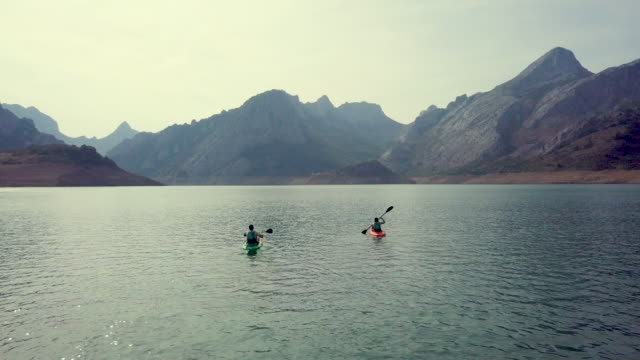 Couple kayaking on a lake aerial drone view