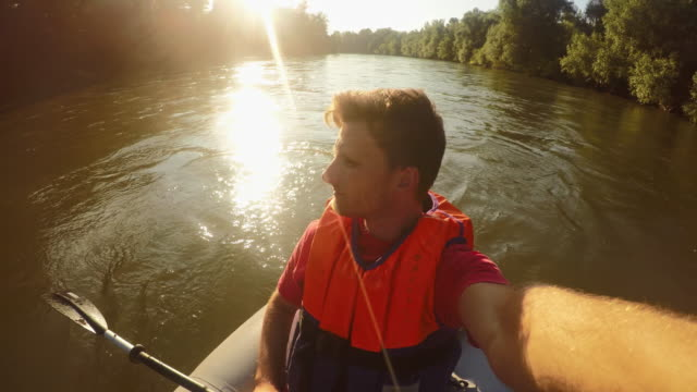 couple kayaking on the river - prekmurje stock videos & royalty-free footage