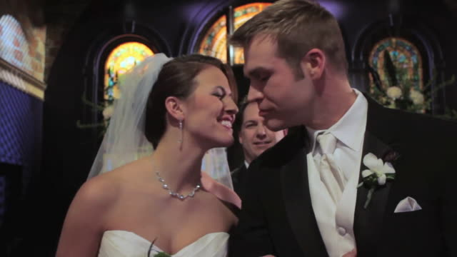 couple kisses at alter: pull to guests clapping - pastor stock videos & royalty-free footage