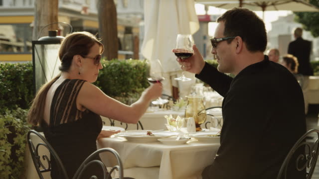ms couple kissing  and feeding each other in outdoors restaurant / venice,veneto - romance stock videos & royalty-free footage