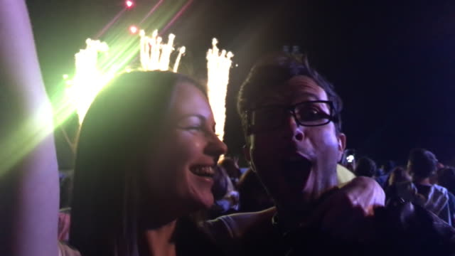 couple kissing at a night concert during fireworks - kissing stock videos & royalty-free footage