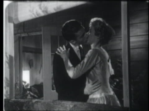 vídeos y material grabado en eventos de stock de b/w 1957 couple (lynne gorman & craig slocum) kissing + hugging on porch - 1957