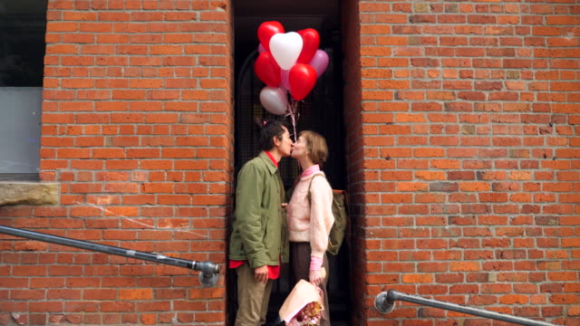 ms couple kissing in doorway while on valentines day date - affectionate stock videos & royalty-free footage