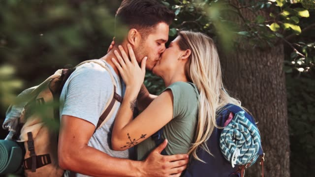 couple kissing in forest during vacation - kissing stock videos & royalty-free footage